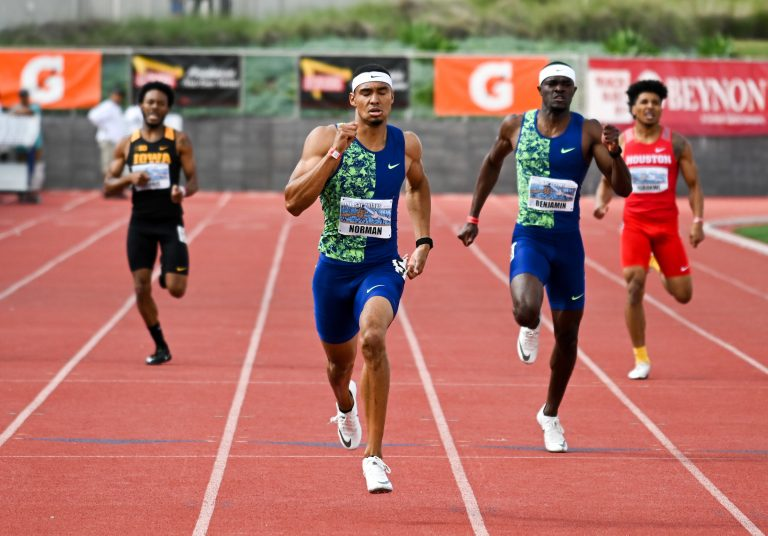 Michael Norman (center) and Ria Benjamin place first and second in the 400m in 43.45 and 44.31 during the 61st Mt. San Antonio College Relays, Saturday, April 20, 2019, in Torrance, Calif. Norman's time moved him into a tie for fourth on the all-time world performer list.