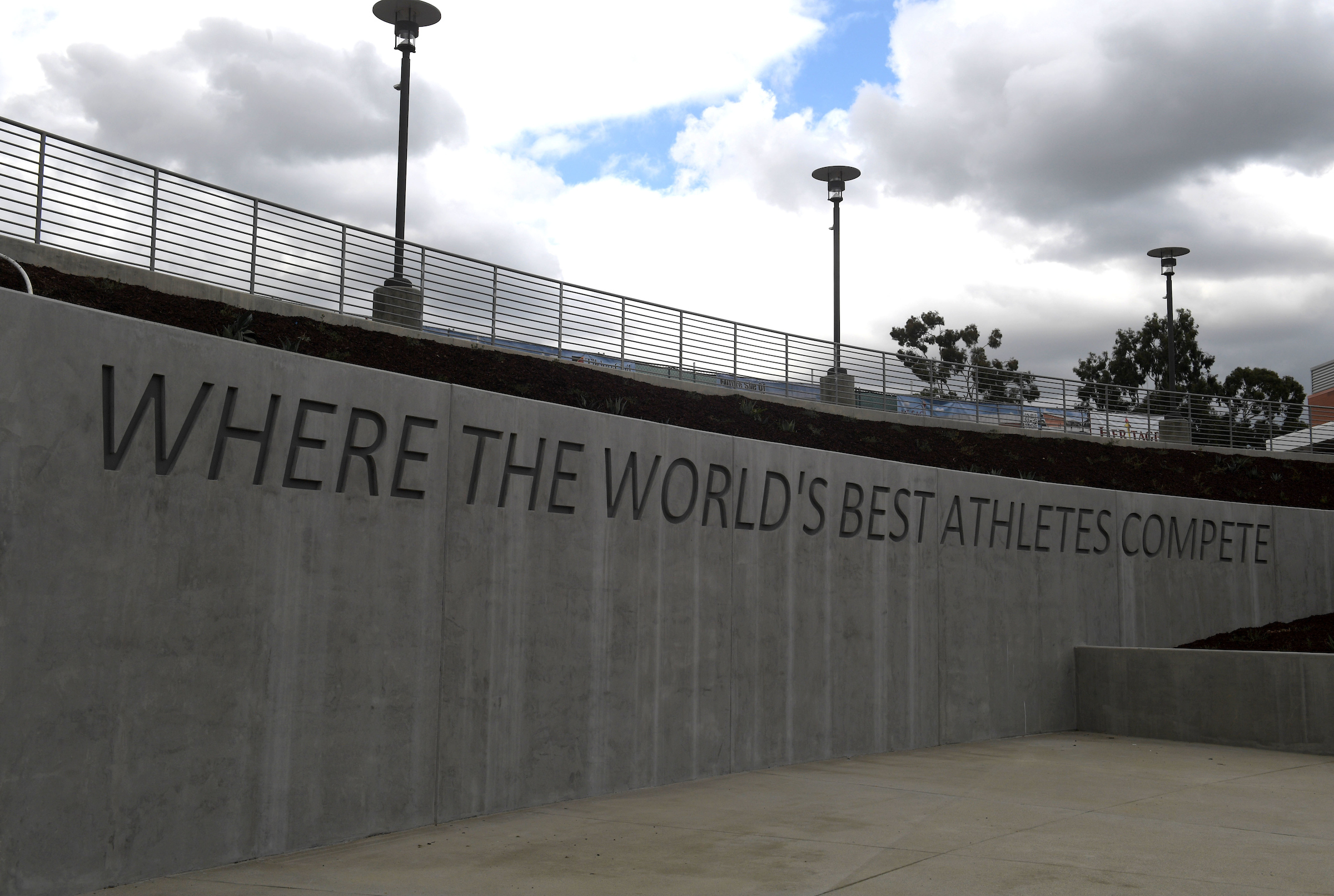 "Where the World's Best Athlete's Compete"" is inscribed on the wall around the first bend of the newly renovated Hilmer Lodge Stadium"