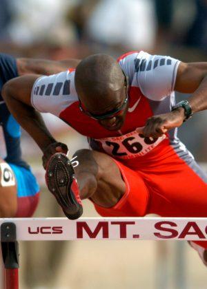 Allen Johnson wins the invitational men's 110-meter high hurdles